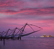 Chinese fishnets on sunset. Kochi, Kerala, India Royalty Free Stock Photos