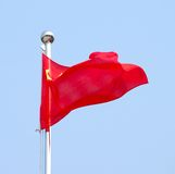 Chinese flag. Close up, against blue sky Stock Photos