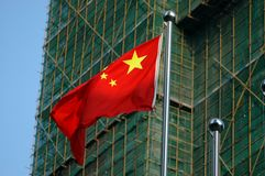 Chinese flag with buildings behind Royalty Free Stock Image