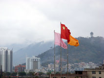 Chinese flag and Chinese city. Chinese flags flying over a Chinese city Stock Image