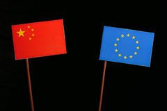 Chinese flag with European Union EU flag isolated on black Royalty Free Stock Image