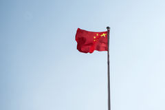 The Chinese flag flies in the blue sky Stock Images