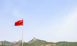Chinese flag in front of the chinese wall stock photo