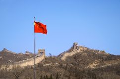 The Chinese Flag Before The Great Wall Of China Stock Photography