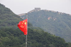 Chinese Flag with Great Wall of China in Background stock image