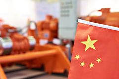 Chinese flag on industrial equipment. Background stock image