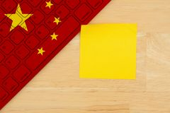 Chinese flag keyboard with a blank a sticky note. For your message royalty free stock images