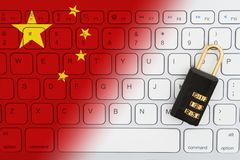 Chinese flag keyboard with a combination lock. For internet security stock photo