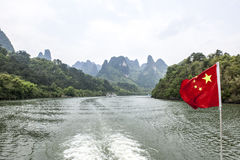 Chinese flag over the Li-River Royalty Free Stock Image