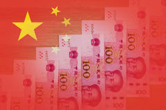 Chinese flag with 100 RMB notes positioned as rising stairs. Sym Stock Photos