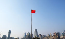 Chinese Flag in Shanghai, China. Skyscraper office buildings. In the background Stock Images
