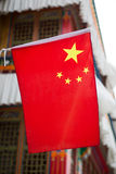Chinese flag on a traditional Tibetan house Stock Photography