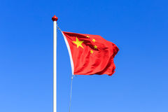 Chinese flag. A Chinese flag is waving in the wind under blue sky Royalty Free Stock Photo