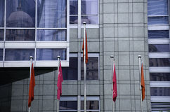 Chinese flags in front of the building. The flags are in front of a business building in China Stock Photo