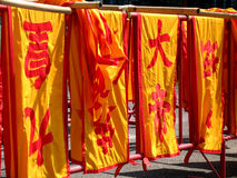 Chinese flags in Phuket town. Phuket town, chinese area with typical red and orange flags Royalty Free Stock Photos