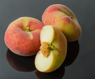 Chinese flat peaches with half Royalty Free Stock Photography