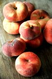 Chinese flat peaches  on a wood background Royalty Free Stock Image