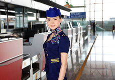 Chinese flight attendant in airport Stock Photo