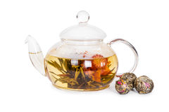 Chinese flowering tea in a glass teapot. Isolated on white background royalty free stock photo