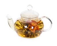 Chinese flowering tea in a glass teapot Stock Photos