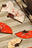 Chinese folding fan. Folding fan in Chinese traditional style, with flower painting on Royalty Free Stock Photography