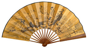 "Chinese folding fan. China yellow paper folding fan with Chinese ink painting of ""Eight Immortals"" isolated on white, thats a most widely circulated Han Stock Photography"