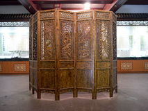 A Chinese folding screen. A Chinese wooden folding screen Stock Image