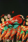 Chinese folk dance : hot girls. CHENGDU - DEC 10: Group dance Hot girls performed by Sichuan Song And Dance Troupe at Golden theater in the 7th national dance Stock Photos