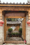 Chinese folk house with door open Royalty Free Stock Photo