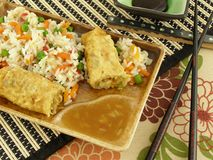Chinese Food. Egg Roll with Chopsticks on bamboo mat Royalty Free Stock Photo