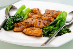 Chinese Food. Stir fried fish fillets and vegetable on a plate royalty free stock image
