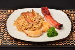 Chinese food. Combination of Chinese food with pork ribs and pasta with shrimp Royalty Free Stock Photos