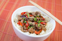 Chinese food. With beef and coriander. Rise on the side and paprika making it very delicious Royalty Free Stock Image