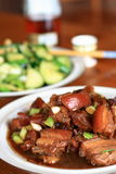 Chinese food. A table of chinese style cooking pork and vegs stock photos