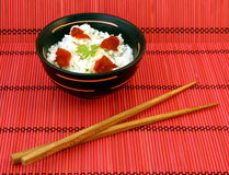 Chinese food. In a black plate and sticks stock photo