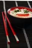 Chinese food. In a black plate and sticks royalty free stock photography
