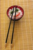 Chinese food. In a black plate and sticks royalty free stock photos