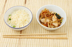 Chinese food on bamboo matt Stock Photo