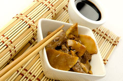 Chinese food, beef with bamboo and mushrooms Royalty Free Stock Images