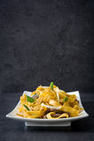 Chinese food. Beef chow mein on black stone Royalty Free Stock Photo