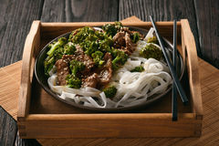 Chinese food - beef prepared with broccoli and rice noodles. Royalty Free Stock Photos