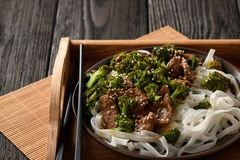Chinese food - beef prepared with broccoli and rice noodles. Stock Image