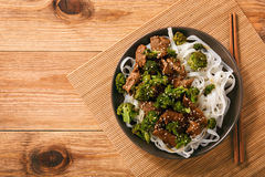 Chinese food - beef prepared with broccoli and rice noodles. Stock Images