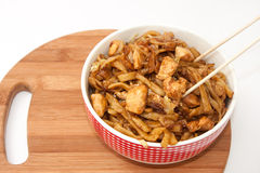 Chinese food in a bowl with chopsticks Stock Photo