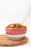 Chinese food in a bowl with chopsticks Royalty Free Stock Image