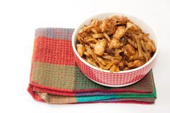 Chinese food in a bowl on the kitchen tablecloth Stock Photos