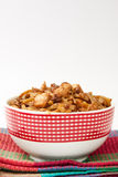 Chinese food in a bowl on the kitchen tablecloth Stock Photo