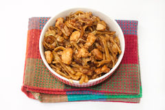 Chinese food in a bowl on the kitchen tablecloth Royalty Free Stock Images