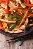 Chinese food: chicken with vegetables vertical top view Stock Images