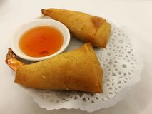 Chinese food in China town, Crispy shrimp deep fried spring roll serve with sweet chill in the local traditional Chinese restauran Stock Photo